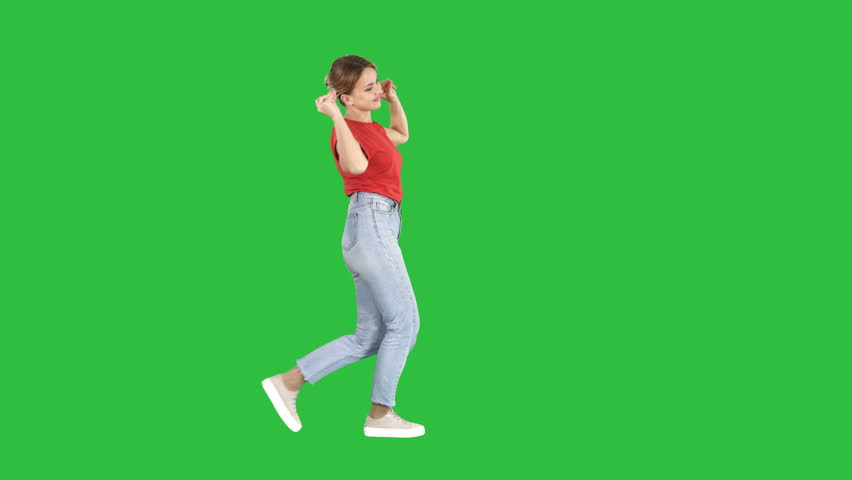Happy smiling woman dancing and having fun on a Green Screen, Chroma Key. | Shutterstock HD Video #1022243659