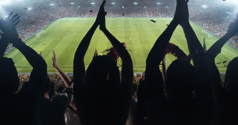Fans clapping hands to cheer their favorite sports team on the stands of the professional stadium. Stadium is made in 3D and animated. | Shutterstock HD Video #1022278189