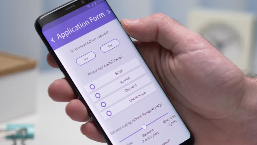 User filling an application form on his smartphone screen. Closeup on the device. | Shutterstock HD Video #1022334889