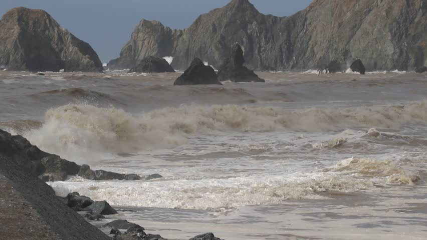 Swirling waves on River end. The Russian river coloring brown the Pacific ocean after rain. Seagulls are on Goat Rock Beach, Sonoma County, California winter.   | Shutterstock HD Video #1022337199