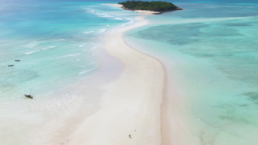 Aerial orbit and dolly of incredible Nosy Iranja island spit off a short cruise from Nosy Be, Madagascar | Shutterstock HD Video #1022403949
