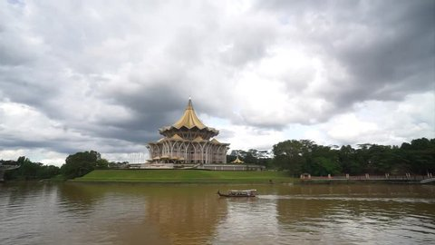 Kuching Sarawak - Circa Dec 2016 : Footage of Sarawak River with Sarawak State Assembly building at background during cloudy day. Sarawak is the largest state in Malaysia.