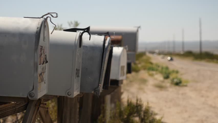 Row of mailboxes in American desert. Roads of Nevada and Arizona. Abandoned place near the road. Far away from cities.