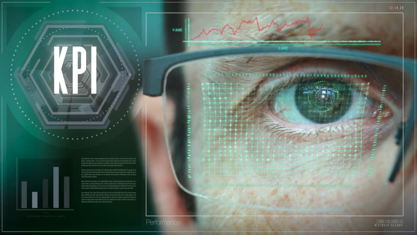A close up of a businessman eye controlling a futuristic computer system with a Business KPI concept. | Shutterstock HD Video #1022543659