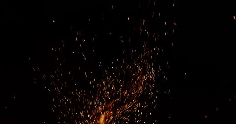 Campfire burning at night spray sparks slow motion 4k