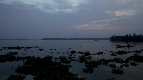 Silhouette of boat and fisherman in backwaters crossing , Steady Shot