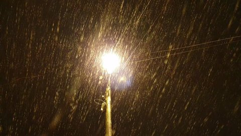 Lamppost and snowfall.Lamppost in winter.
