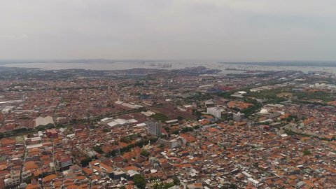Aerial cityscape densely built asian city, seaport. urban environment in asia. modern city Surabaya with buildings and houses. Surabaya capital city east java, indonesia