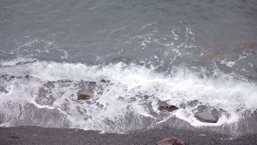 The waves wash the rocky beach | Shutterstock HD Video #1022628079