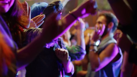 Footage of a crowd or group of young, stylish multi-ethnic people during colorful party in different clothes . Dancers having fun dancing at a party . Shot on RED HELIUM Cinema Camera in slow motion .