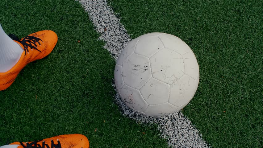 Soccer ball on the center point of a football field, a player starting the match, 4k | Shutterstock HD Video #1022665789
