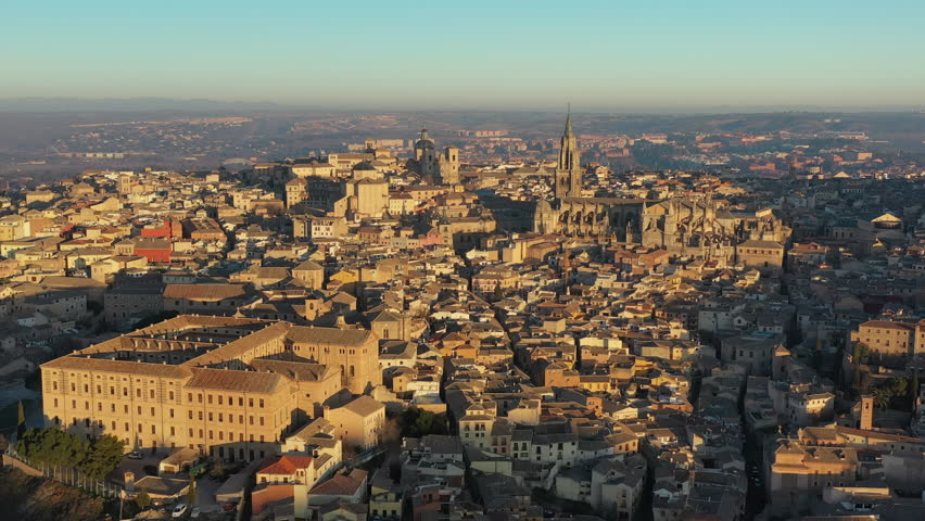 Aerial view of cityscape of Toledo at sunrise, historic center of city, cathedral Santa Iglesia Catedral Primada de Toledo - landscape panorama of Castilla–La Mancha from above, Spain, Europe | Shutterstock HD Video #1022700109