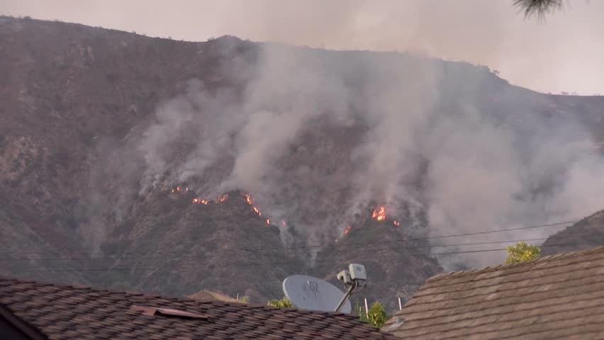 Hillside Burning Above Residential Property in Los Angeles - San Gabriel Complex Fire Circa June 2016.   Shutterstock HD Video #1022737039