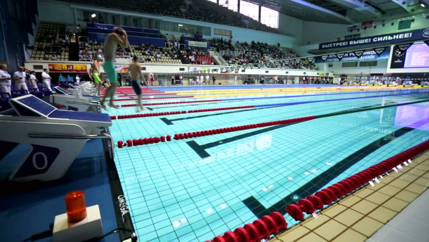 moscow russia april 19 2015 athletes starts to swim backstroke during championship