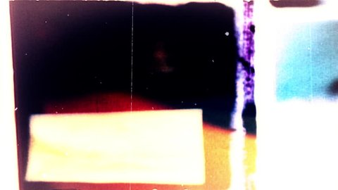 Abstract film leader forms flicker and pulse (Loop).