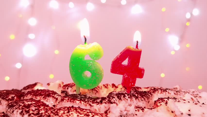 Burning Birthday Candle On A Cake Number 64 Blow Out At The End Color Blurred Background