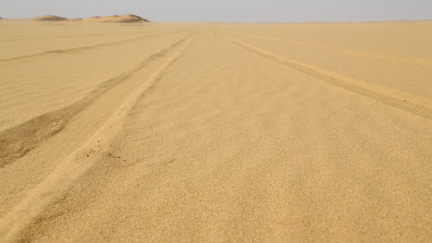 In the middle of the desert rock and track like concept of wild and nature scenic land   | Shutterstock HD Video #1022804839