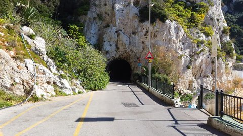 Motorcycles entering a road tunnel in Gibraltar.