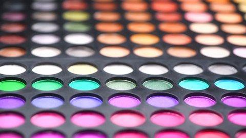 Makeup set, make-up palette. Professional multicolour make up eyeshadows palette, bright vivid colors and tints of eye shadows set. Dolly shot, background. Makeup artist tools. 4K UHD video