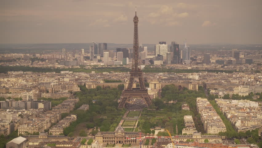 Large view of the city of Paris with the Eiffel Tower and the La Defense district behind, France | Shutterstock HD Video #1022819479