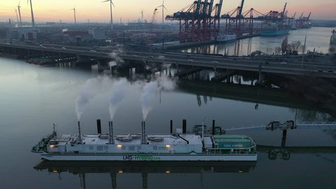 HAMBURG - JAN 19: LNG Hybrid Barge January 19, 2019 in Hamburg, Germany. Hummel LNG Hybrid Barge on its berth in the port of Hamburg. It was developed in order to supply clean energy for cruise ships.
