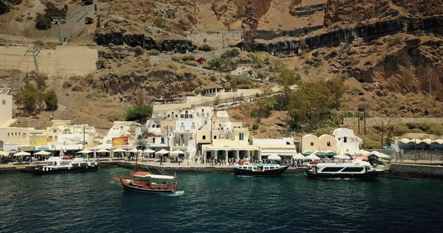 Aerial panning of the port of Thira with cable cars coming down. Santorini, Greece.  | Shutterstock HD Video #1022842249