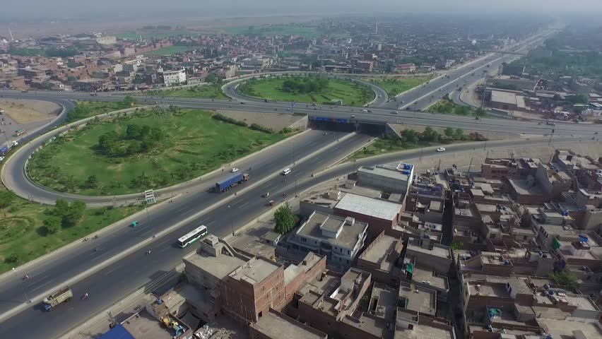Aerial fly over of people commuting on a new section of the Ring Road in Lahore, Pakistan | Shutterstock HD Video #1022842279