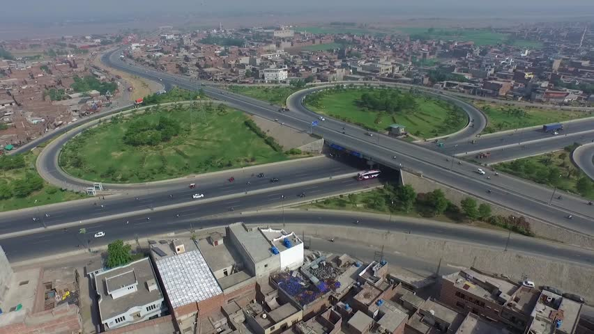 Tracking aerial view of cars commuting on the new section of the busy ring road in Lahore, Pakistan | Shutterstock HD Video #1022842339
