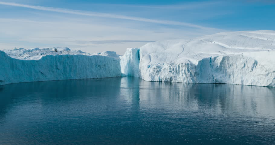 Global Warming and Climate Change - Giant Iceberg from melting glacier in Ilulissat, Greenland. Aerial drone of arctic nature landscape famous for being heavily affected by global warming. | Shutterstock HD Video #1022844979