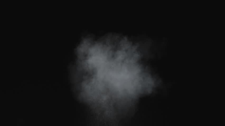 Dusty bullet hits on a wall with chunks of debris flying out .  Powder explosion on black background. Impact  dust particles. Dust explosion in front of black background, slow-motion close up. VFX  | Shutterstock HD Video #1022865379