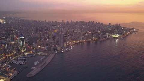 Flying over Beirut bay marina and downtown. Drone aerial shot of Beirut, Lebanon, during sunset.