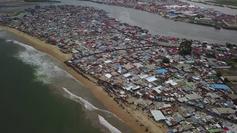 Aerial over massive slum on beach in third world country