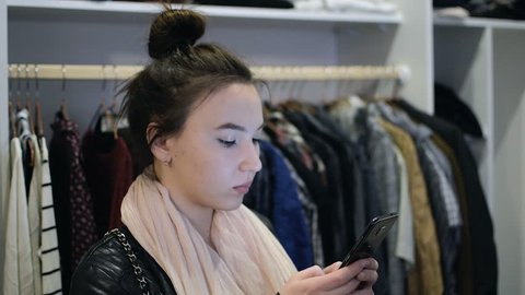f6bb2bc49eb1b Two Women Browse the Clothes Stock Footage Video (100% Royalty-free ...
