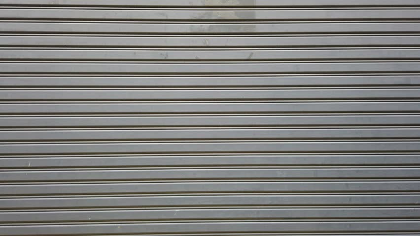 Gray storage door zoom in  | Shutterstock HD Video #1023029509