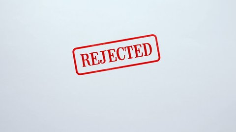 Rejected seal stamped on blank paper background application not approved, denied