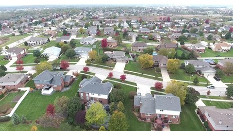 Overhead aerial view of residential houses and yards along suburban street - Travel and leisure concept