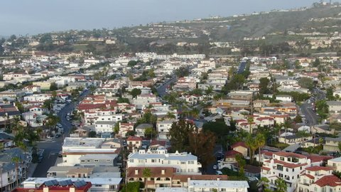 Aerial view of San Clemente coastline city with nice luxury and wealthy villas before sunset time. San Clemente city in Orange County, California, USA.