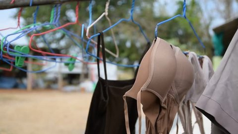 groups of bras hanging on open air