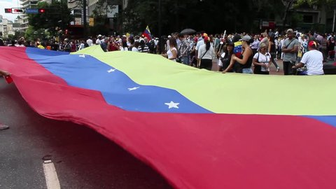 Caracas/Venezuela - January 30, 2019: Protesters march and filled streets across Venezuela in a show of strength for Juan Guaido, the U.S. backed opposition leader declared himself interim president