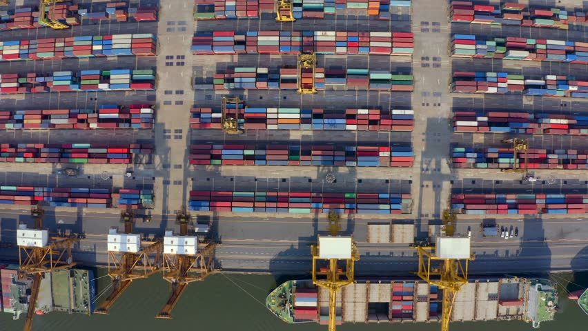 Aerial shot of pier in port of Bangkok, Thailand.Top view of container ship in export and import business and logistics. Shipping cargo to harbor by crane. International water transport concept. | Shutterstock HD Video #1023355069