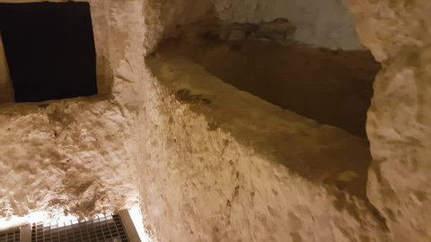 Rabat, Malta - August 04 2016: Interior of Saint Paul Catacombs hypogea tunnels. Inside the low ceiling narrow paths of underground galleries and tombs in the Saint Agatha complex area.