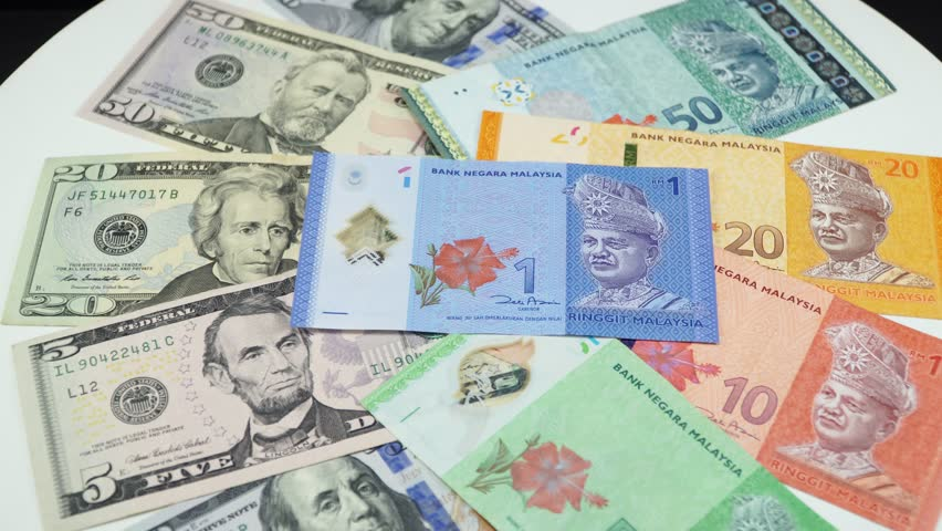 Us Dollar And Malaysia Money On The Table Rotating 4k