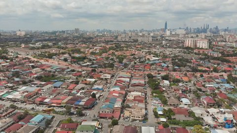 Panorama of all of Kuala Lumpur from the far outskirts of the city. Malaysia. Drone aerial footage.