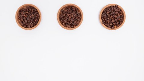 Stop motion footage of coffee beans in shape of cup, hart and bean. Coffee love concept.