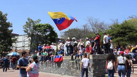 Caracas / Venezuela February 2, 2019: A senior lady waves Venezuelan flag in a rally against Venezuelan President Nicolas Maduro government and back Juan Guaido interim president