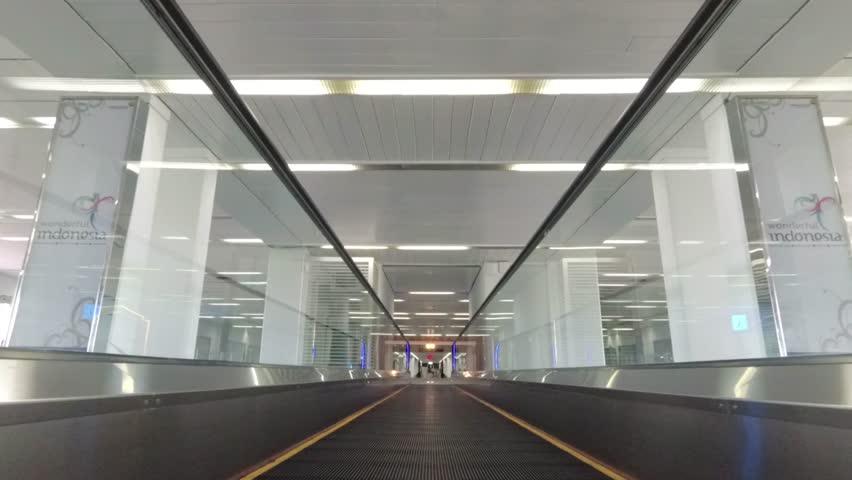 A Moving Walkway or Moving Sidewalk (American English), also known as an Autowalk or in British English as a Skywalk, Horizontal Escalator, Flat Escalator, Travolator, Travelator   Shutterstock HD Video #1023559369