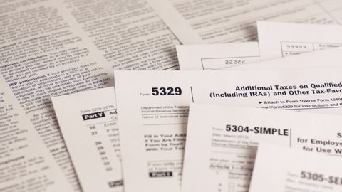 Tax forms 5329, 5304-simple, 5305-ser and personal plan 401k . Close-up