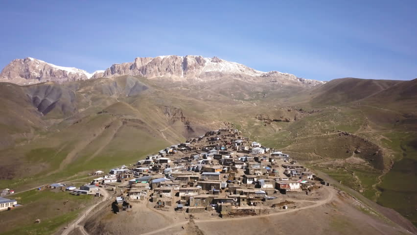 Aerial View Of Old Village With Snow Covered Mountain In The Background