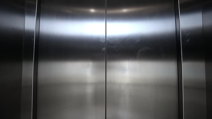 Elevator is arriving and doors open automatically - HD stock footage clip & Floor And White Repoussage Doors Of Entrance Of Building Stock ... Pezcame.Com