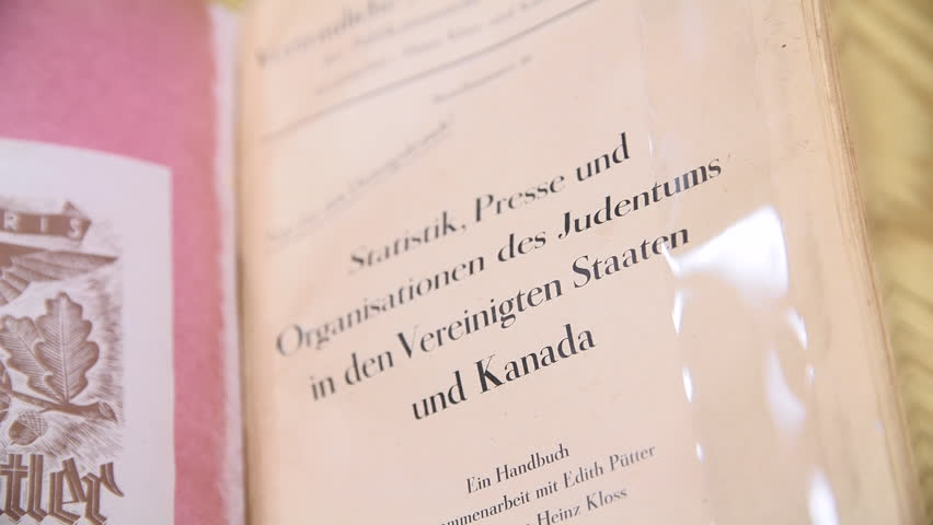 Ottawa, Canada - January 2019 - A book acquired by the Canadian Library and Archives shows a report detailed by Nazi scientists explaining how to implement the final solution in North America | Shutterstock HD Video #1023930199